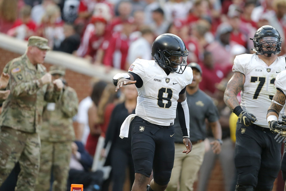 Photo - Army's Kelvin Hopkins Jr. (8) celebrates after a touchdown during a college football game between the University of Oklahoma Sooners (OU) and the Army Black Knights at Gaylord Family-Oklahoma Memorial Stadium in Norman, Okla., Saturday, Sept. 22, 2018. Photo by Bryan Terry, The Oklahoman