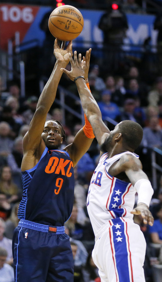 Photo - Oklahoma City's Jerami Grant (9) shoots against Philadelphia's James Ennis III (11) in the first quarter during an NBA basketball game between the Philadelphia 76ers and the Oklahoma City Thunder at Chesapeake Energy Arena in Oklahoma City, Thursday, Feb. 28, 2019. Photo by Nate Billings, The Oklahoman