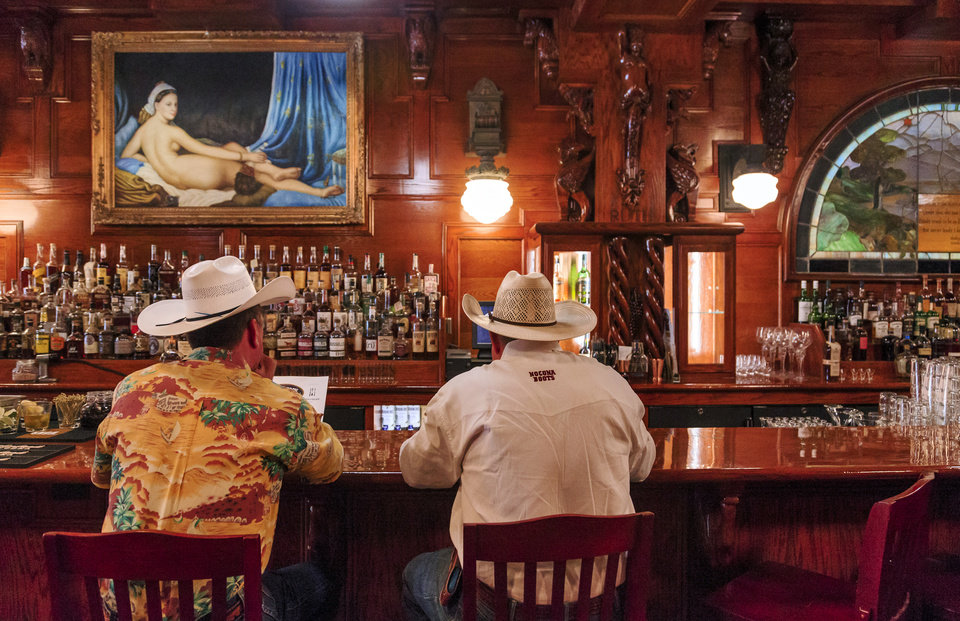 Photo -  Customers sit at the bar for lunch at McClintock Saloon and Chop House in Oklahoma City. [CHRIS LANDSBERGER/THE OKLAHOMAN]