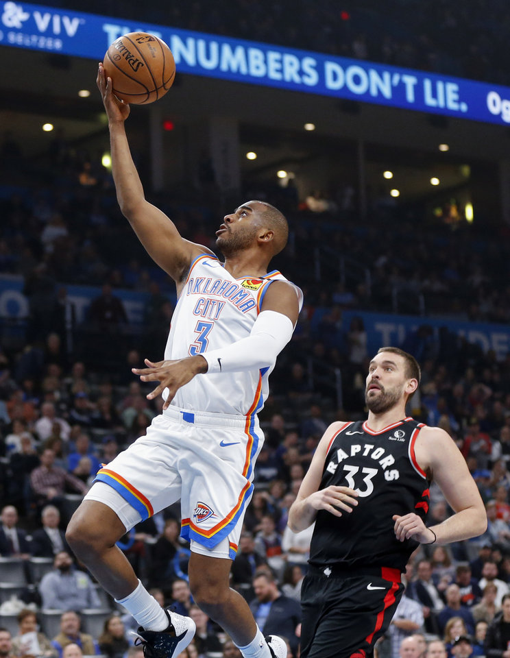 Photo - Oklahoma City's Chris Paul (3) lays the ball up in front of Toronto's Marc Gasol (33) in the first quarter during an NBA basketball between the Oklahoma City Thunder and the Toronto Raptors at Chesapeake Energy Arena in Oklahoma City, Wednesday, Jan. 15, 2020. [Nate Billings/The Oklahoman]