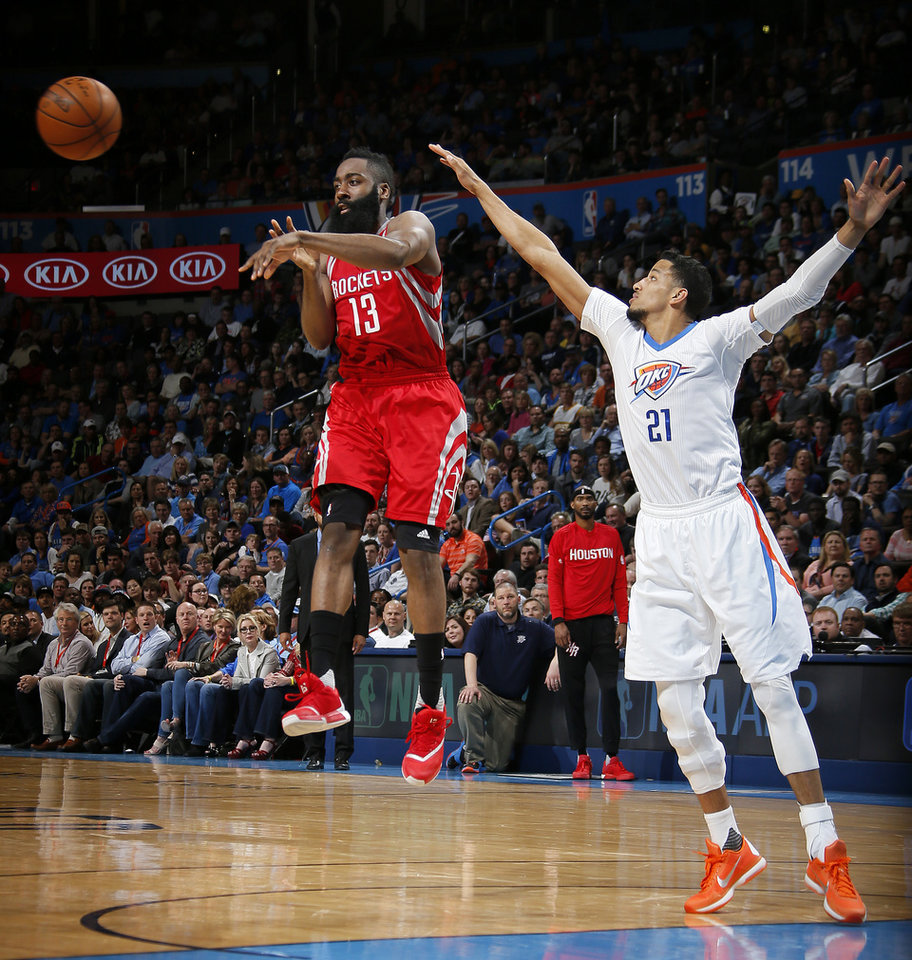 Photo - Houston's James Harden (13) passes the ball as Oklahoma City's Andre Roberson (21) defends during an NBA basketball game between the Oklahoma City Thunder and the Houston Rockets at Chesapeake Energy Arena in Oklahoma City, Tuesday, March 22, 2016. Oklahoma City won 111-107. Photo by Bryan Terry, The Oklahoman