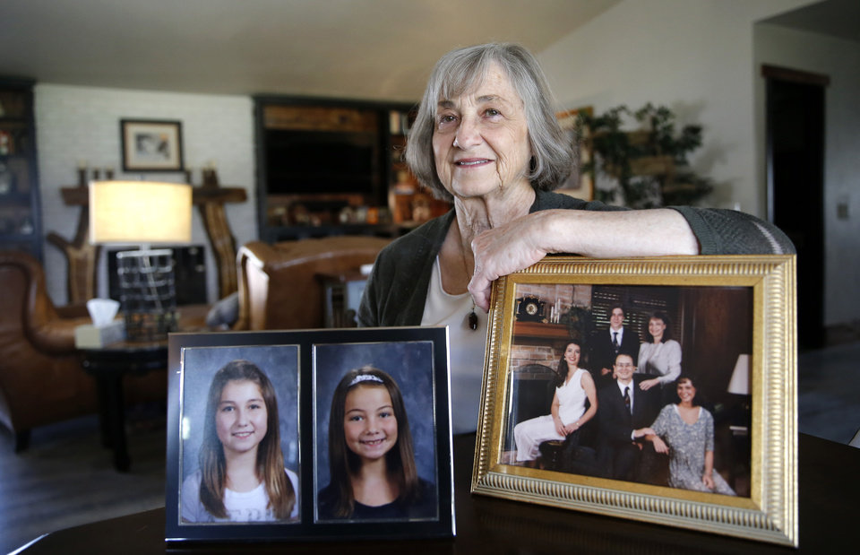 Photo - Helen Coffey poses with a picture of her grand children Aubrey and Alyssa. And of her family, front row from left Heather Coffey Knapton, Dewayn Coffey, Elaina Coffey and back row Doug Coffey and Helen Coffey,  in Edmond, Okla.,  Thursday, April 19, 2018. Photo by Sarah Phipps, The Oklahoman