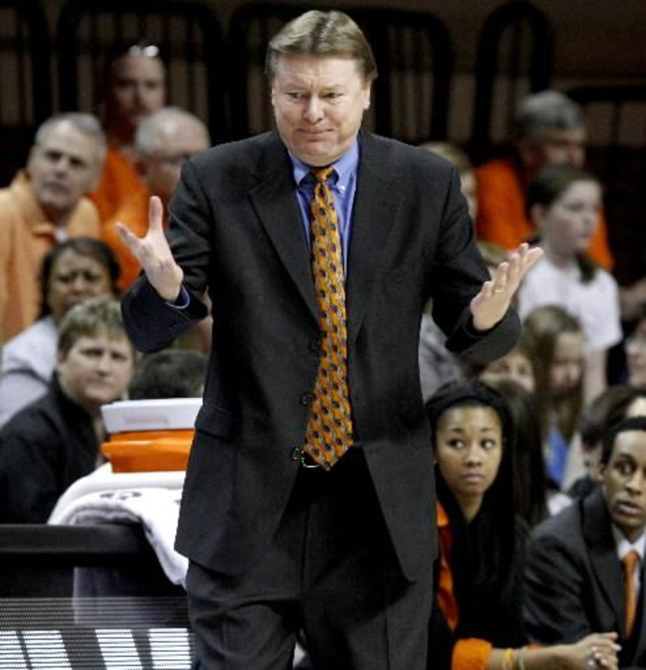 Photo - OSU coach Kurt Budke reacts during the Bedlam women's college basketball game between the University of Oklahoma Sooners and the Oklahoma State University Cowgirls at Gallagher-Iba Arena in Stillwater, Okla., Saturday, January 29, 2011. Photo by Bryan Terry