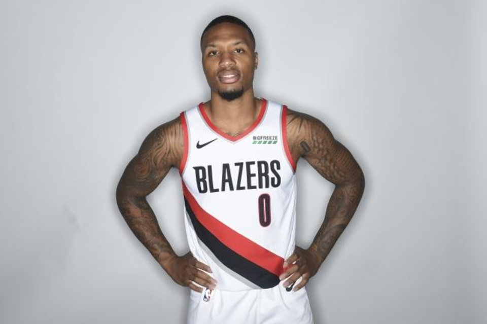 Photo -  Damian Lillard of the Portland Trail Blazers poses for a photo during media day in Portland, Ore., Monday, Sept. 24, 2017. (AP Photo/Steve Dykes)