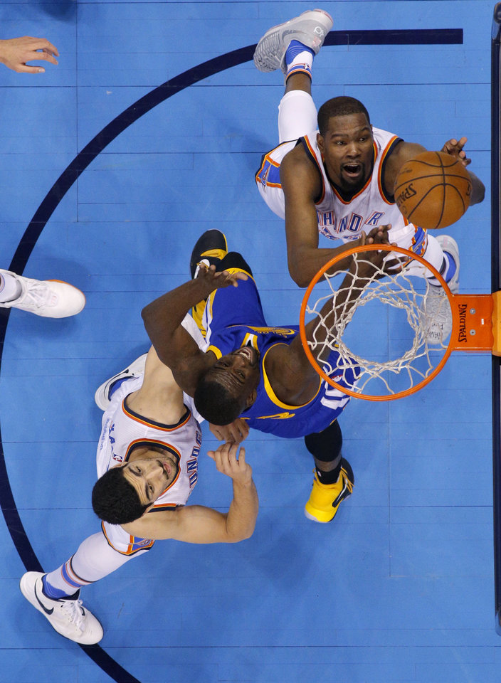 Photo - Oklahoma City's Kevin Durant (35) shoots over Golden State's Draymond Green (23) as Enes Kanter (11) watches during Game 3 of the Western Conference finals in the NBA playoffs between the Oklahoma City Thunder and the Golden State Warriors at Chesapeake Energy Arena in Oklahoma City, Sunday, May 22, 2016. Oklahoma City won 133-105. Photo by Bryan Terry, The Oklahoman