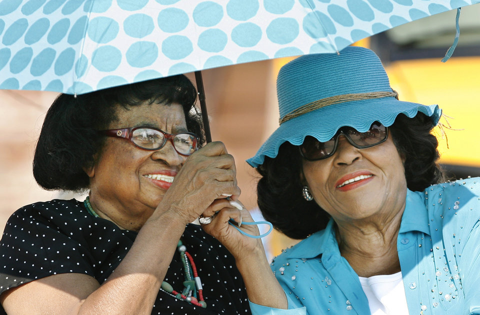 Photo - The Walnut Avenue Bridge was reopened and formally named the G.E. Finley Bridge during ceremonies Friday morning,  7/21/2006. The bridge has been under construction since 2004 and is one of the city's main gateways into Bricktown. Among those attending the event were longtime civil rights activist Clara Luper, left, and Oklahoma City school board member Thelma Parks, share an umbrella to shade them from morning sun's heat.   By  Jim Beckel /The Oklahoman.