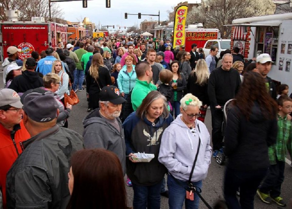 Photo -  A crowd gathers near food trucks during the season's first Heard on Hurd in downtown Edmond in March. [Photo by Doug Hoke, The Oklahoman]