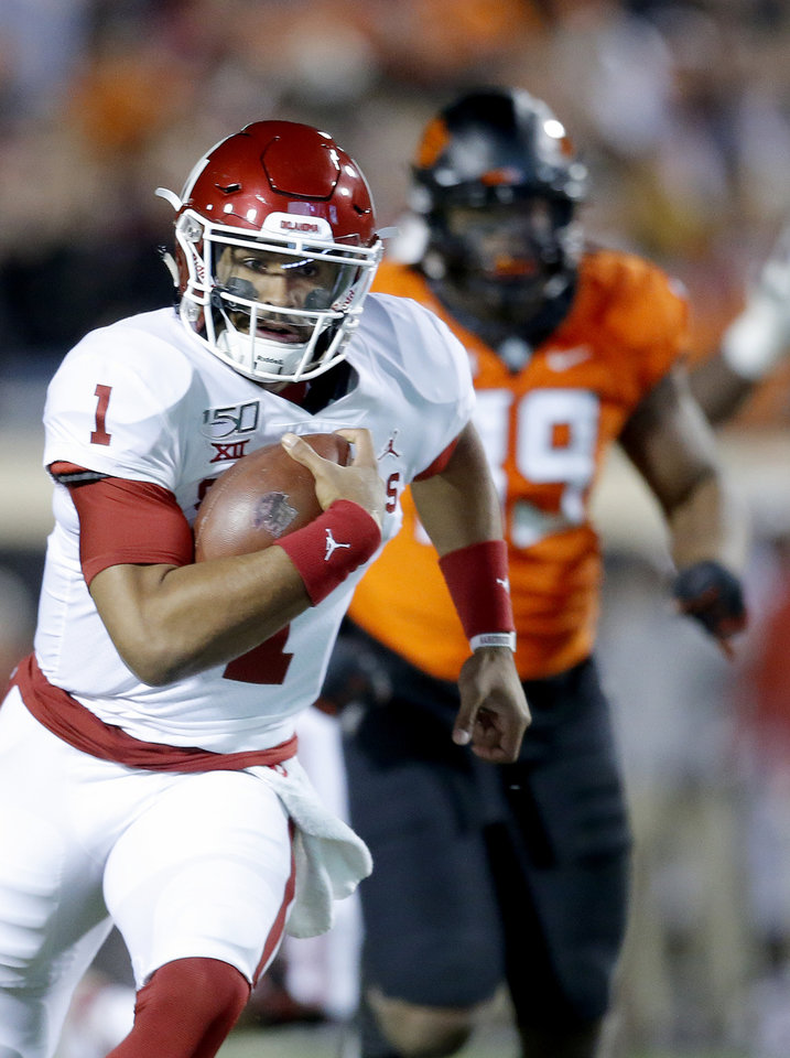Photo - Oklahoma's Jalen Hurts (1) rushes for a touchdown in the first quarter during the Bedlam college football game between the Oklahoma State Cowboys (OSU) and Oklahoma Sooners (OU) at Boone Pickens Stadium in Stillwater, Okla., Saturday, Nov. 30, 2019. [Sarah Phipps/The Oklahoman]