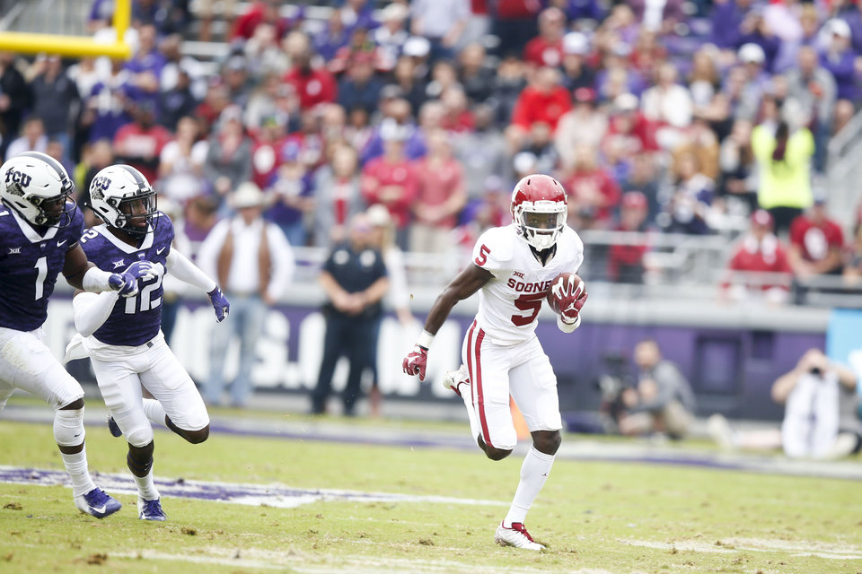 813d3ce58 Oklahoma Sooners wide receiver Marquise Brown (5) outruns TCU Horned Frogs  linebacker Jawuan Johnson
