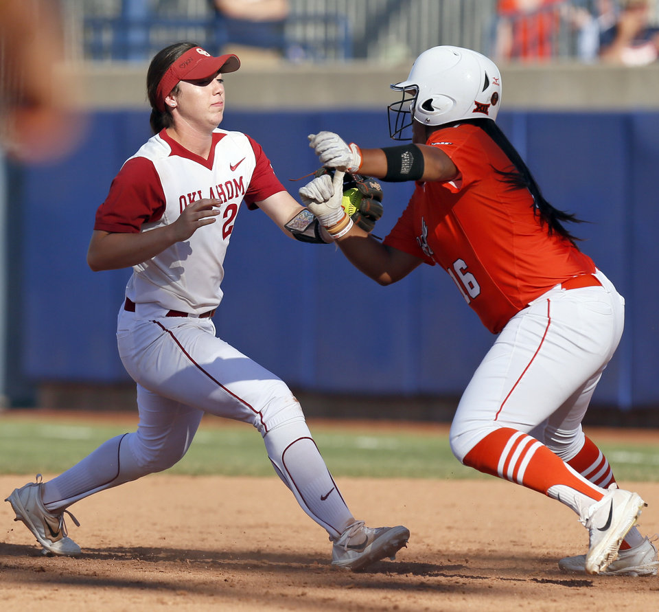 Photo - OU's Caleigh Clifton (20) tags out OSU's Hayleigh Galvan (16) in the sixth inning during the championship game of the Big 12 softball tournament between Oklahoma and Oklahoma State at ASA Hall of Fame Stadium in Oklahoma City, Saturday, May 13, 2017. OU won 2-0. Photo by Nate Billings, The Oklahoman