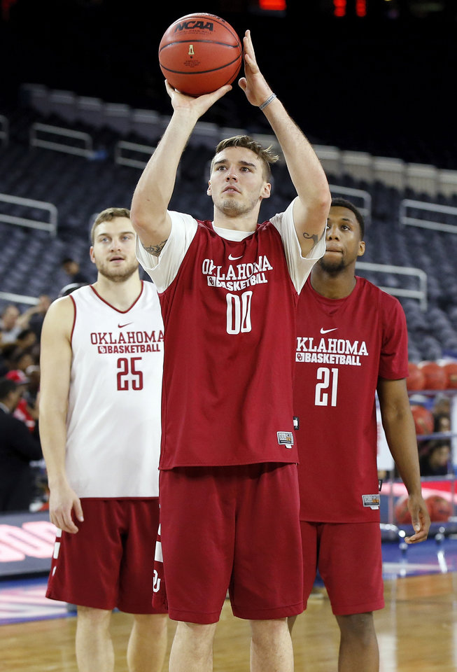 Photo - Oklahoma's Ryan Spangler (00) shoots in front of C.J. Cole (25) and Dante Buford (21) during practice on Final Four Friday before the national semifinal between the Oklahoma Sooners and the Villanova Wildcats in the NCAA Men's Basketball Championship at NRG Stadium in Houston, Friday, April 1, 2016. OU will play Villanova in the Final Four on Saturday. Photo by Nate Billings, The Oklahoman