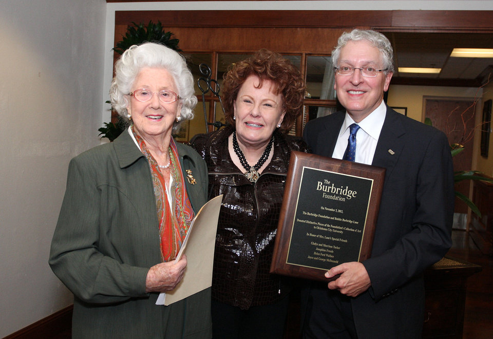 Photo - Josephine Freede, Bobbie Burbridge Lane and Robert Henry attend the dedication ceremony for the art collection donation.