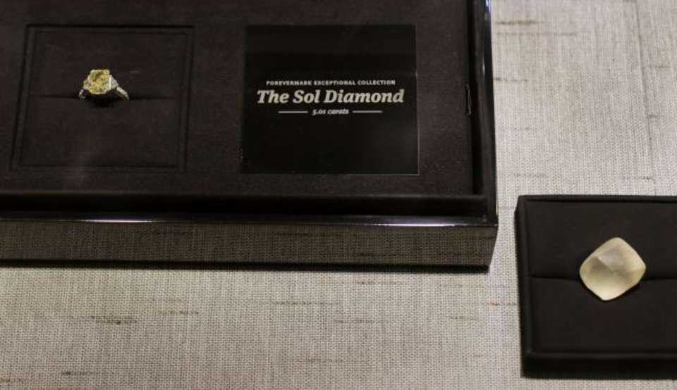 Photo -  The Sol diamond with the replica of the raw stone from which it was cut. [Doug Hoke/The Oklahoman]