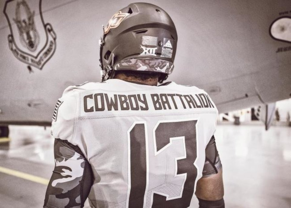 Photo -  Oklahoma State's commemorative jerseys on Saturday feature