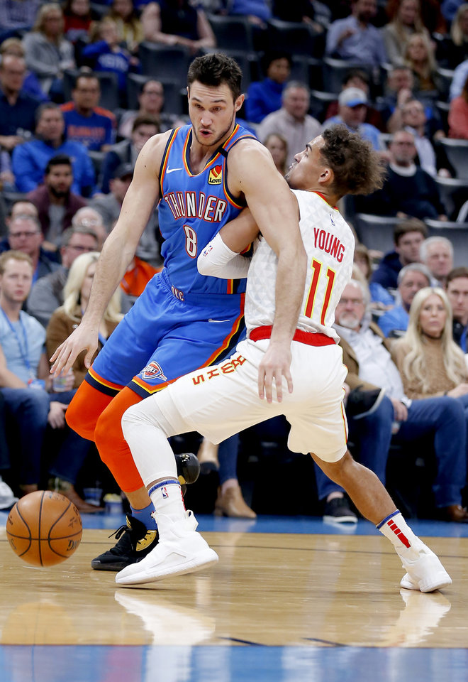 Photo - Oklahoma City's Danilo Gallinari (8) gets by Atlanta's Trae Young (11) during the NBA basketball game between the Oklahoma City Thunder and the Atlanta Hawks at the Chesapeake Energy Arena in Oklahoma City,Friday, Jan. 24, 2020.  [Sarah Phipps/The Oklahoman]