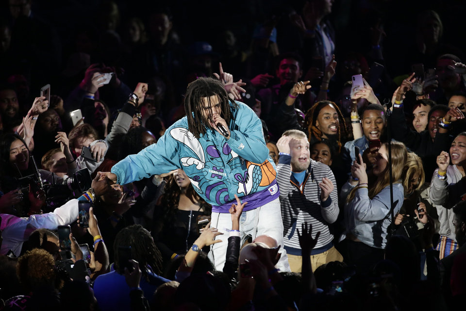 Photo - Rapper J. Cole performs at halftime during NBA All-Star basketball game, Sunday, Feb. 17, 2019, in Charlotte, N.C. (AP Photo/Gerry Broome)