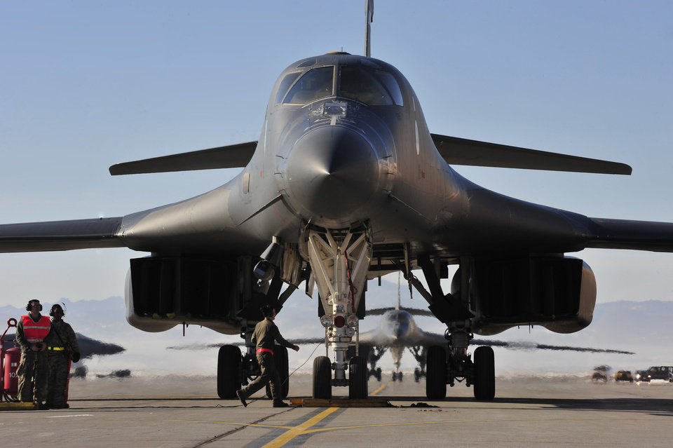 Photo - A 28th Bomb Wing B-1 taxis down the runway at Ellsworth Air Force Base, S.D., after returning from deployment in Southwest Asia, Jan. 19, 2016. The B-1 was part of a record setting deployment, which dropped more than 3,800 munitions against approximately 3,700 targets. (U.S. Air Force photo by Airman 1st Class James L. Miller/Released)