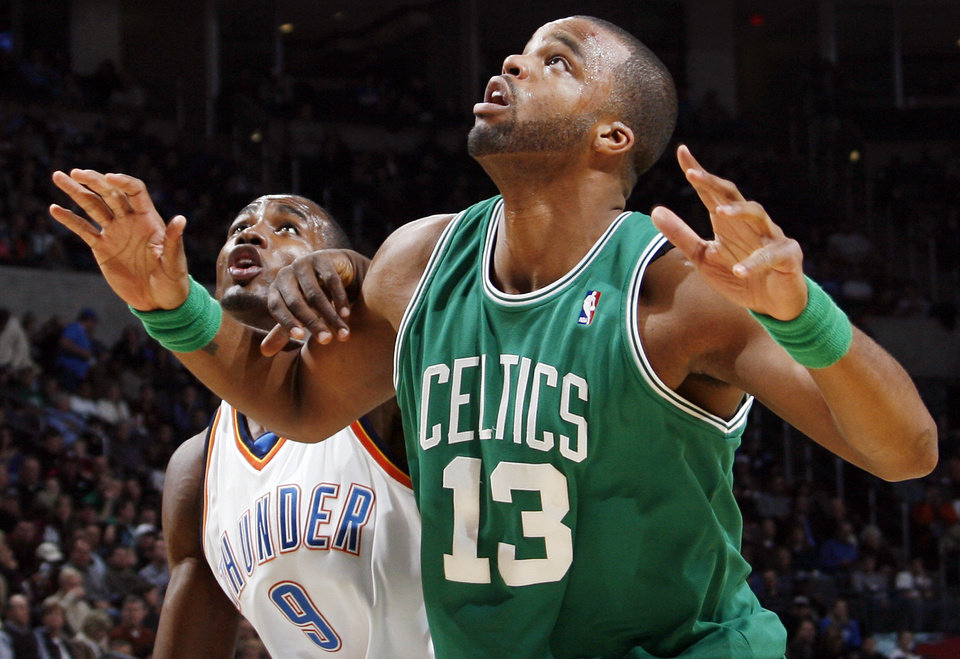 Photo - Shelden Williams (13) of Boston and Oklahoma City's Serge Ibaka (9) fight for position in the first half of the NBA basketball game between the Boston Celtics and the Oklahoma City Thunder at the Ford Center in Oklahoma City, Friday, Dec. 4, 2009. Photo by Nate Billings, The Oklahoman ORG XMIT: KOD