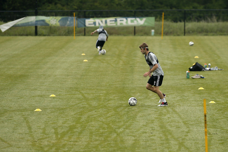 Photo - Energy FC's Tucker Stephenson goes through a drill during soccer practice in Oklahoma City, Wednesday, May 13, 2020. [Bryan Terry/The Oklahoman]