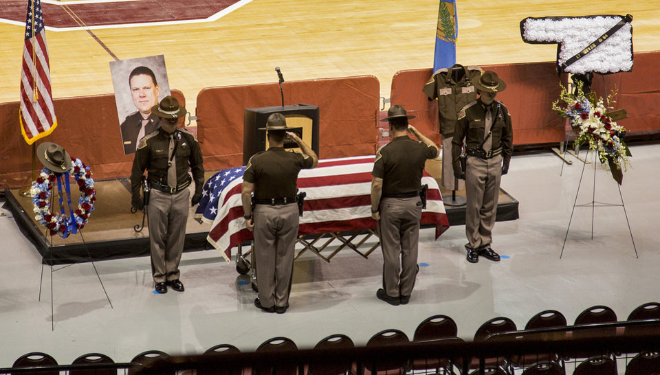 Photo -   Members of the Oklahoma Highway Patrol salute the casket during funeral services for fallen Oklahoman Highway Patrol's Lt. Heath Meyer at the Lloyd Noble Center in Norman, Okla. on Monday, July 31, 2017. [CHRIS LANDSBERGER/THE OKLAHOMAN ARCHIVES]