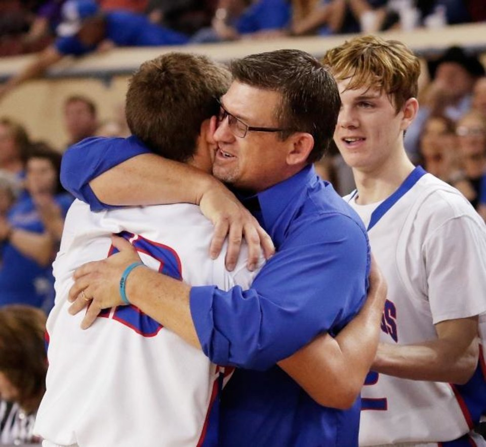 Photo -  Fort Cobb-Broxton coach Scott Hines hugs his son Cameron late in their Class A basketball state championship win in 2016. [OKLAHOMAN ARCHIVES]