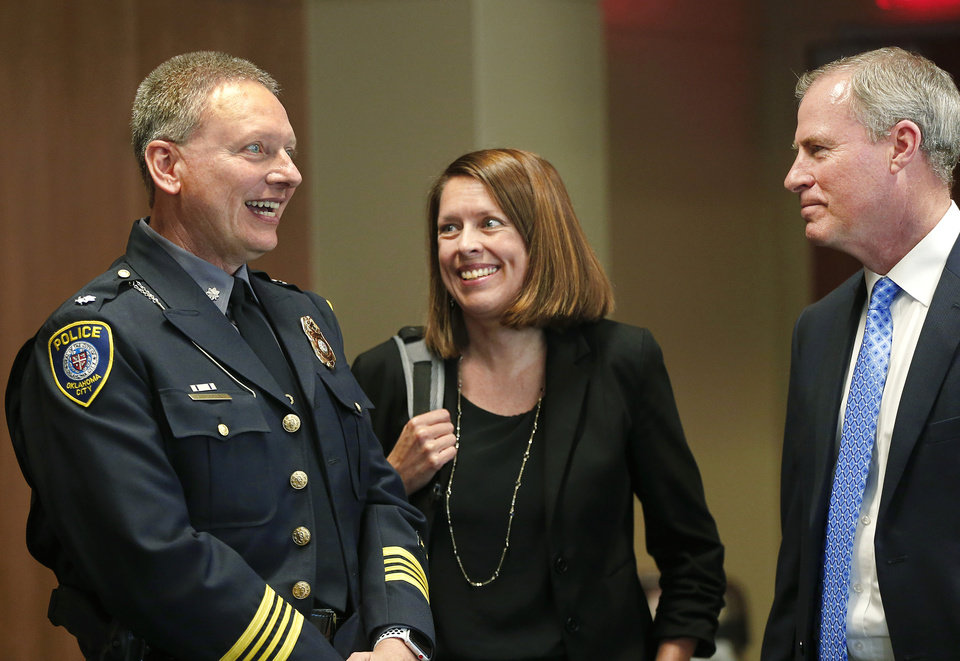 "Photo - New Oklahoma City Police Chief Wade Gourley, left, visits with City Manager Craig Freeman and city spokesperson Kristy Yager a few minutes before Freeman introduced Gourley as the department's new chief at a news conference at police headquarters Monday, July 8, 2019. Gourley has been an Oklahoma City police officer for 30 years and was serving as one of the police department's four deputy chiefs before being promoted to chief. He succeeds former Police Chief Bill Citty, who retired in May after 15 years as head of the department.  Freeman said ""Chief Gourley fits the mold of what we're looking for: he's open, honest, innovative and experienced, and he will lead by example. I'm confident he will lead our police department to continue to serve and protect all residents in a fair and equitable manner.""  Gourley is Oklahoma City's 50th chief. He will lead the 1,235 uniformed officers and 304 other staff members in the police department.  [Jim Beckel/The Oklahoman]"