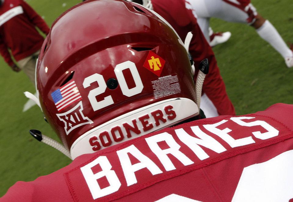 Photo - Oklahoma's Robert Barnes (20) wears a Thunderbird insignia on his helmet during a college football game between the University of Oklahoma Sooners (OU) and the Army Black Knights at Gaylord Family-Oklahoma Memorial Stadium in Norman, Okla., on Saturday, Sept. 22, 2018. Photo by Steve Sisney, The Oklahoman