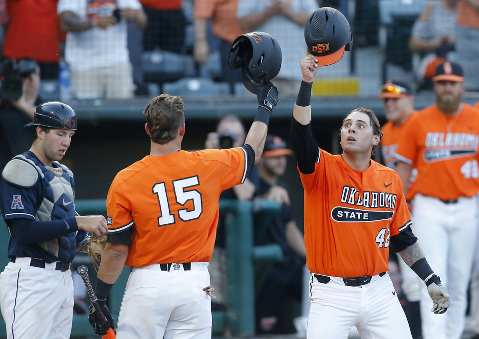 Photo - Oklahoma State's Alix Garcia (42) celebrates a home run with Cade Cabbiness (15) in the 5th inning during the Oklahoma City Regional NCAA baseball game between Oklahoma State University (OSU) and UConn at Chickasaw Bricktown Ballpark in Oklahoma City,  Monday, June 3, 2019. [Sarah Phipps/The Oklahoman]