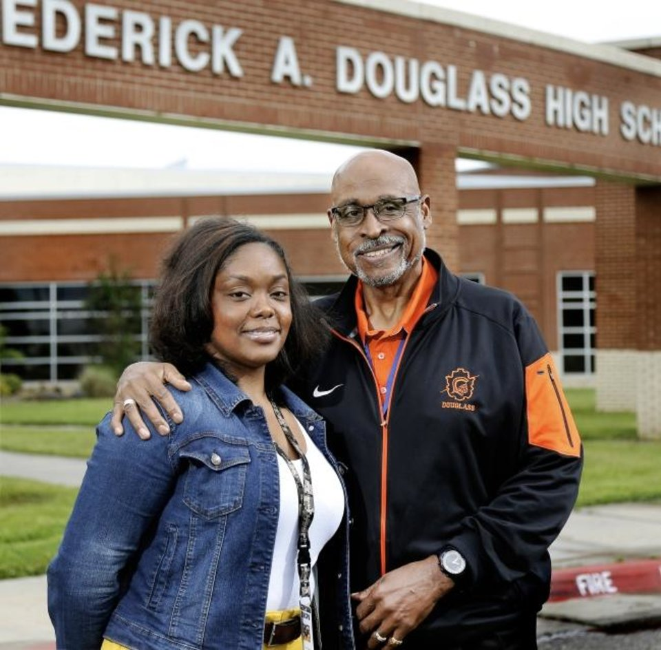 Photo -  Mauri and Robert Hubbard, father-daughter teachers, stand outside Douglass High School where they each taught last school year and where they plan to return for the new school season that begins in August.  [Jim Beckel/The Oklahoman]
