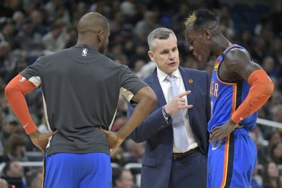 Photo -  Oklahoma City Thunder head coach Billy Donovan, center, and guard Chris Paul, left, talk to guard Dennis Schroder (17) during a timeout in the second half of an NBA basketball game against the Orlando Magic Wednesday, Jan. 22, 2020, in Orlando, Fla. (AP Photo/Phelan M. Ebenhack)