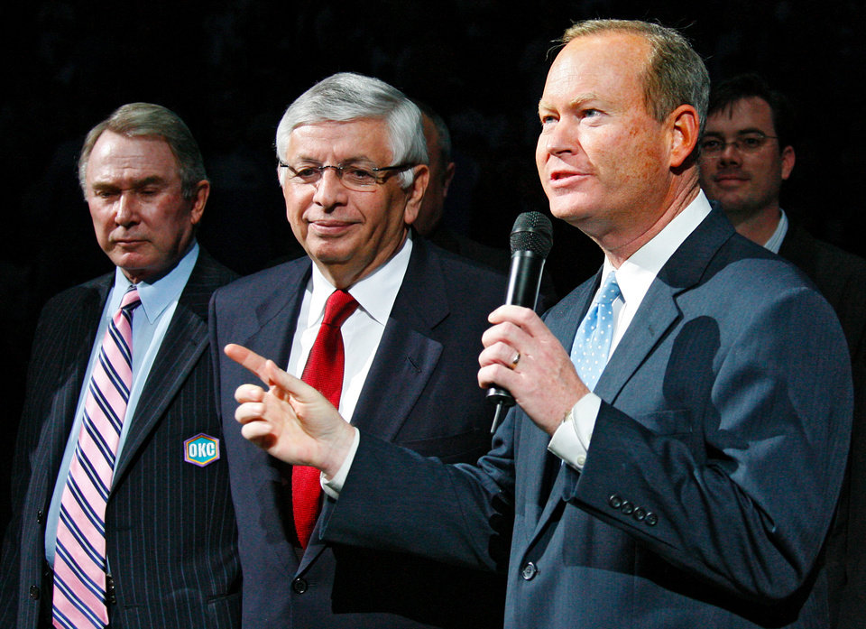 Photo -  In this 2007 photo, Oklahoma City Mayor Mick Cornett, right, addresses fans alongside New Orleans/OKC Hornets owner George Shinn, far left, and NBA Commissioner David Stern. [OKLAHOMAN ARCHIVES]
