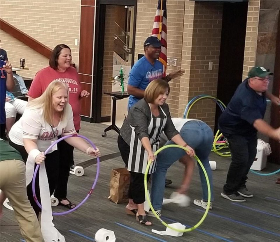 Photo -  Moore Norman Technology Center staff members enjoy a friendly competition during the annual United Way campaign kickoff. [Photo provided]
