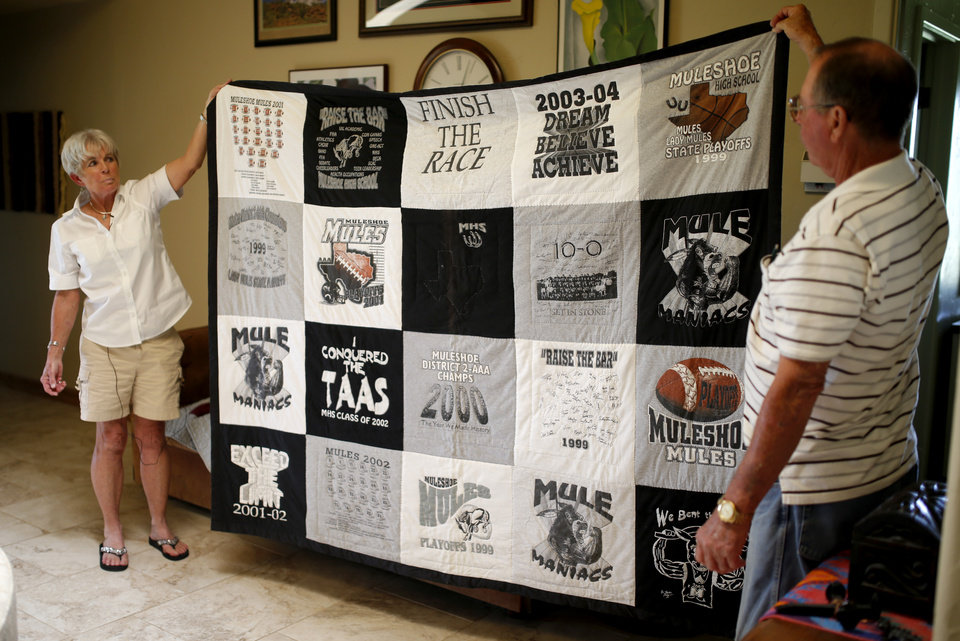 Photo - Bill and Alice Liles hold a quilt made with Muleshoe football t-shirts at their home in Muleshoe, Texas, hometown of Oklahoma's new offensive coordinator Lincoln Riley, on Wednesday, June 24, 2015. Photo by Bryan Terry, The Oklahoman