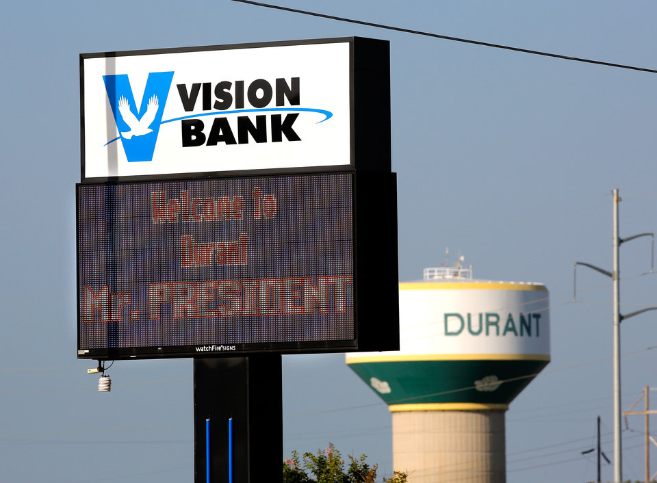 Photo - Many businesses in the southeastern community of Durant are anticipating the visit of President Obama this week and are posting various welcome signs in front of their buildings.  He will speak to selected guests on Wednesday, July 15, 2015, at Durant High School.  Photo by Jim Beckel, The Oklahoman.