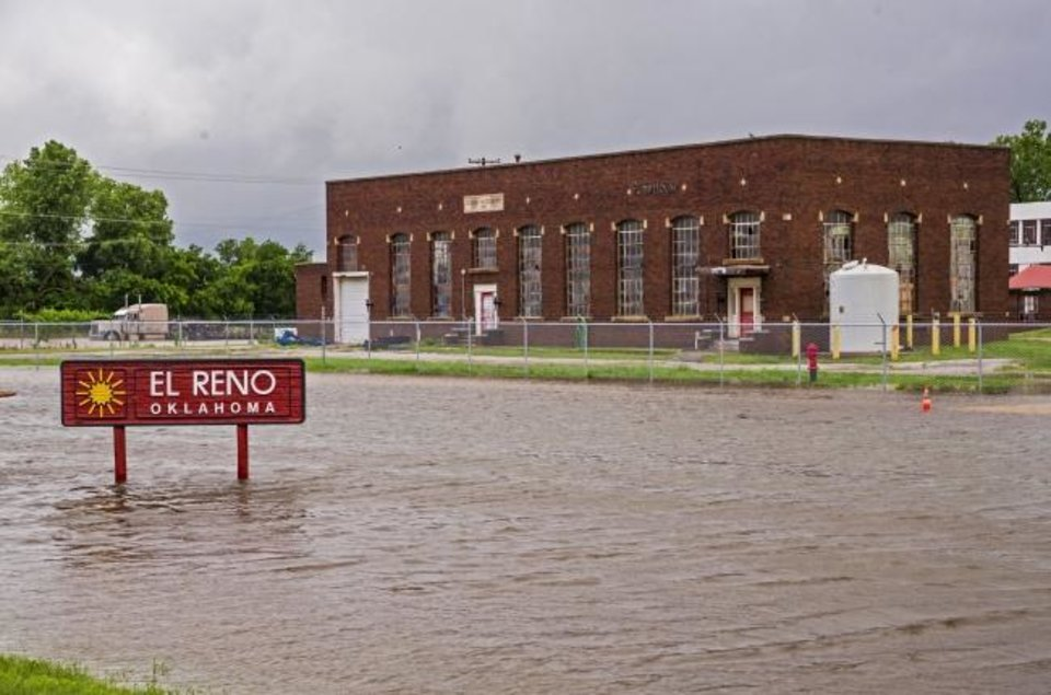 Photo -  Floodwaters surround the Bulk Water Plant in El Reno on Tuesday after heavy rains flooded the area. [Chris Landsberger/The Oklahoman]