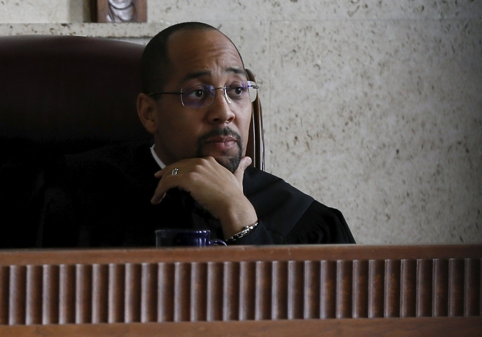 Photo - Judge Bernard M. Jones listens during an injunction hearing on the Douglass-Locust Grove football controversy at the Oklahoma County Courthouse in Oklahoma City, Wednesday, Dec. 10, 2014. Photo by Nate Billings, The Oklahoman