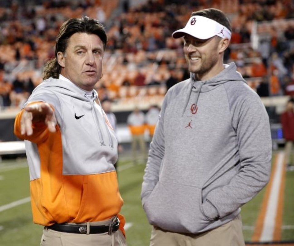 Photo -  OSU coach Mike Gundy and OU coach Lincoln Riley both projected to field playoff hopefuls in 2020. [Sarah Phipps/The Oklahoman]