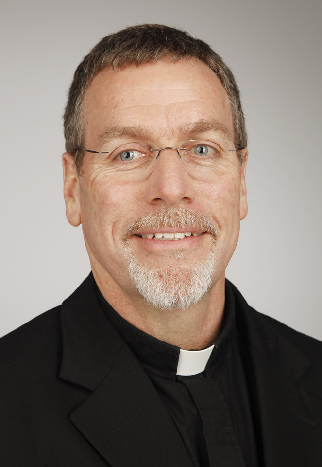 Photo -  The Rev. Tim Luschen, pastor of St. Charles Borromeo Catholic Church. [Photo by Doug Hoke, The Oklahoman]