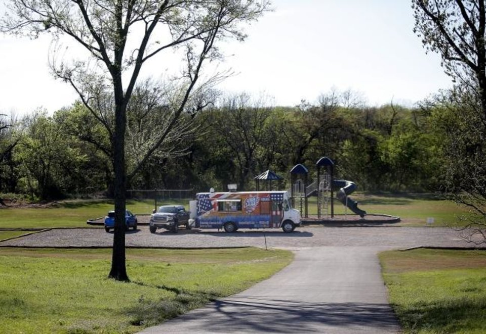 Photo - Blue J's Rollin' Grill food truck sits in a park at The Ridge neighborhood in Edmond, Okla., Tuesday, April 7, 2020. [Sarah Phipps/The Oklahoman]