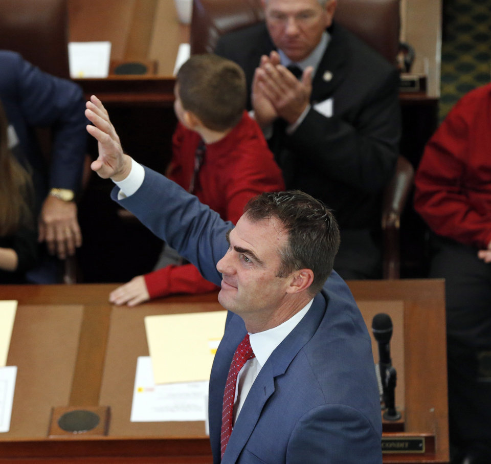 Photo - Gov.-elect Kevin Stitt waves at the start of the oath of office ceremony for newly-elected members of the Oklahoma House of Representatives in the House chamber at the state Capitol in Oklahoma City, Nov. 15, 2018. Photo by Nate Billings, The Oklahoman