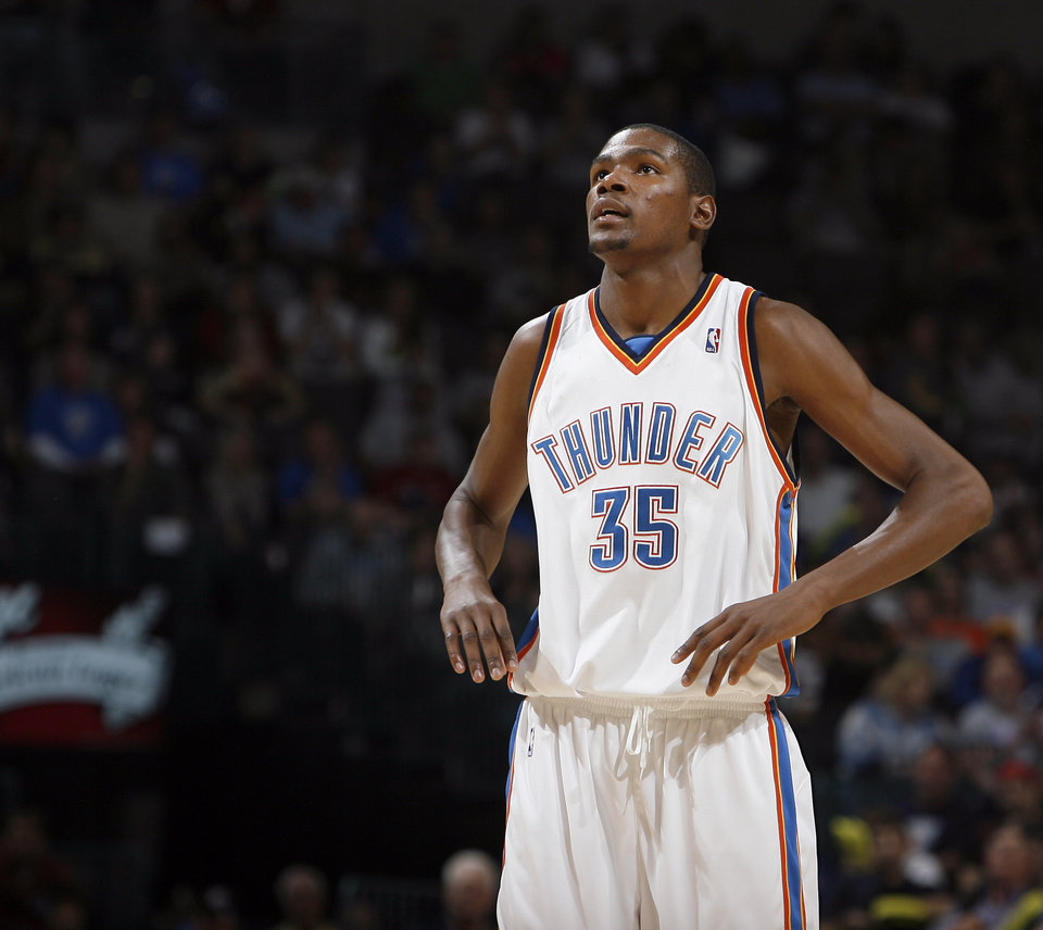 290a9ca0573 Oklahoma City s Kevin Durant (35) looks up at the scoreboard during the  final minute of the NBA basketball game between the Oklahoma City Thunder  and the ...