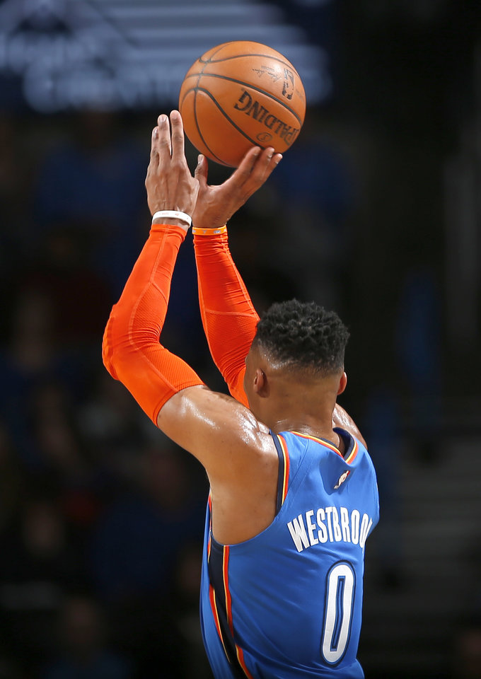Photo - Oklahoma City's Russell Westbrook (0) shoots a 3-point basket during the NBA game between the Oklahoma City Thunder and the Utah Jazz at the Chesapeake Energy Arena, Friday, Feb. 22, 2019. Photo by Sarah Phipps, The Oklahoman