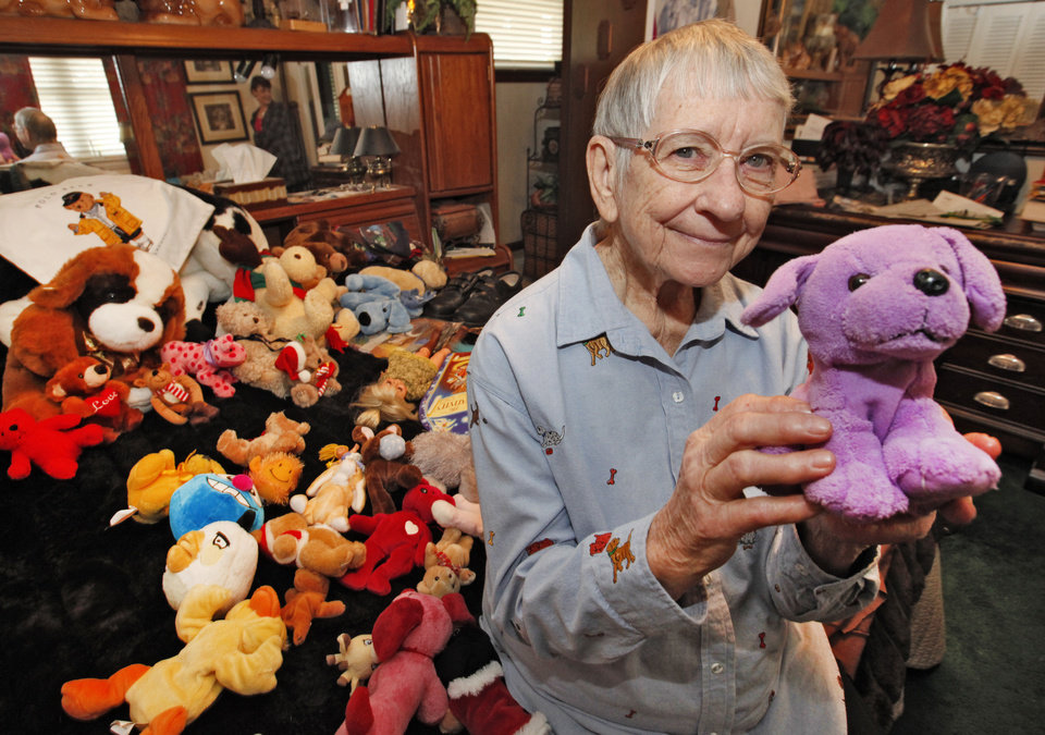 Photo - Faye Flowers makes and collects things to give to the needy. Here, she poses in a room filled with such items. Photo By David McDaniel/The Oklahoman  David McDaniel - The Oklahoman