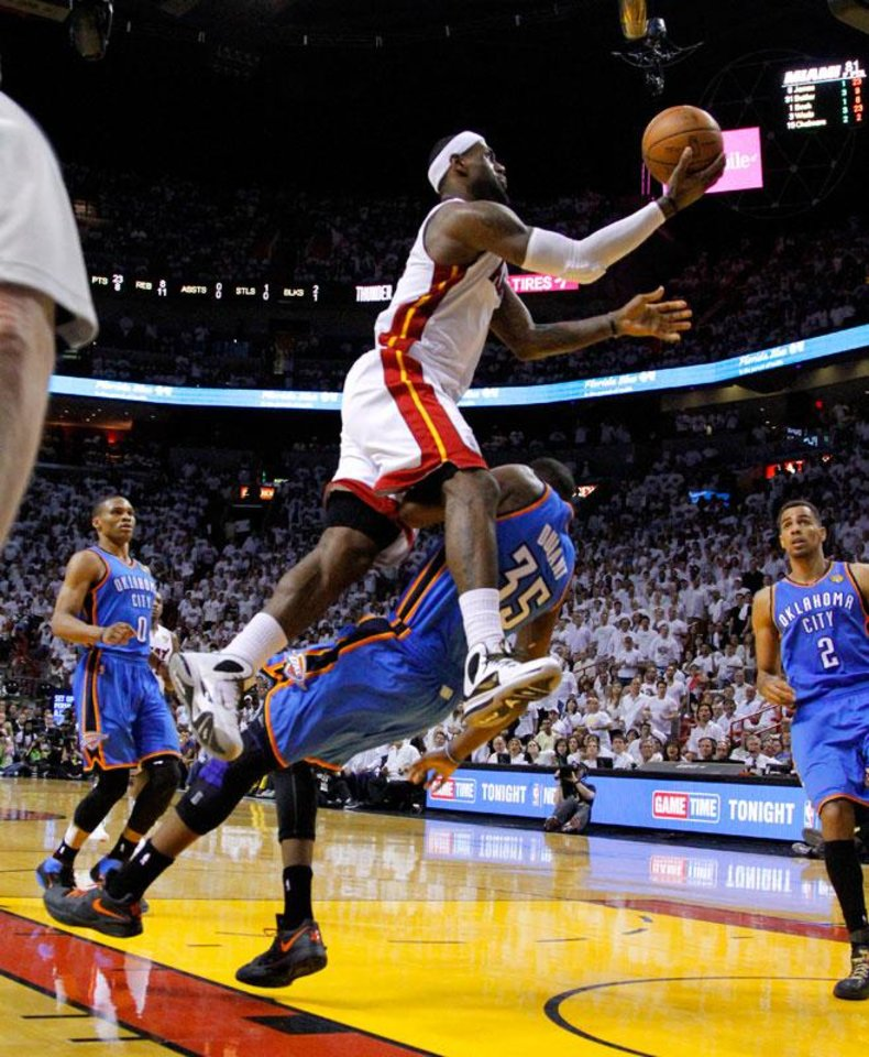 Photo -  Oklahoma City's Kevin Durant (35) fouls Miami's LeBron James (6) late in the fourth quarter of Game 3 of the NBA Finals between the Oklahoma City Thunder and the Miami Heat at American Airlines Arena, Sunday, June 17, 2012. Photo by Bryan Terry, The Oklahoman