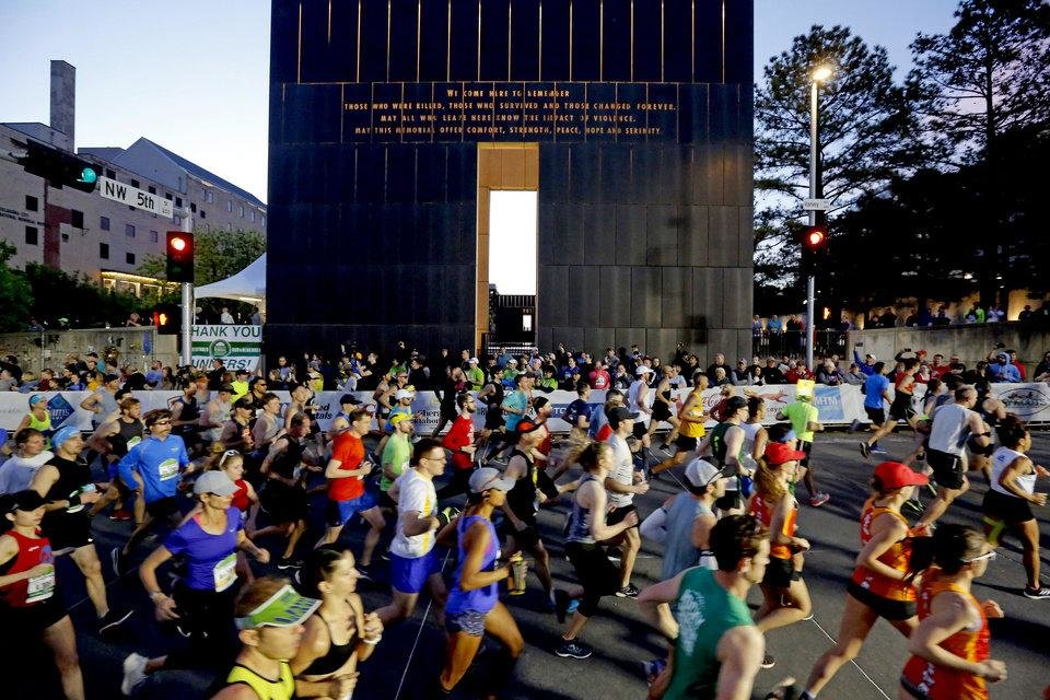 Photo - Runners start the Oklahoma City Memorial Marathon in Oklahoma City, Sunday, April 28, 2019. [Bryan Terry/The Oklahoman]