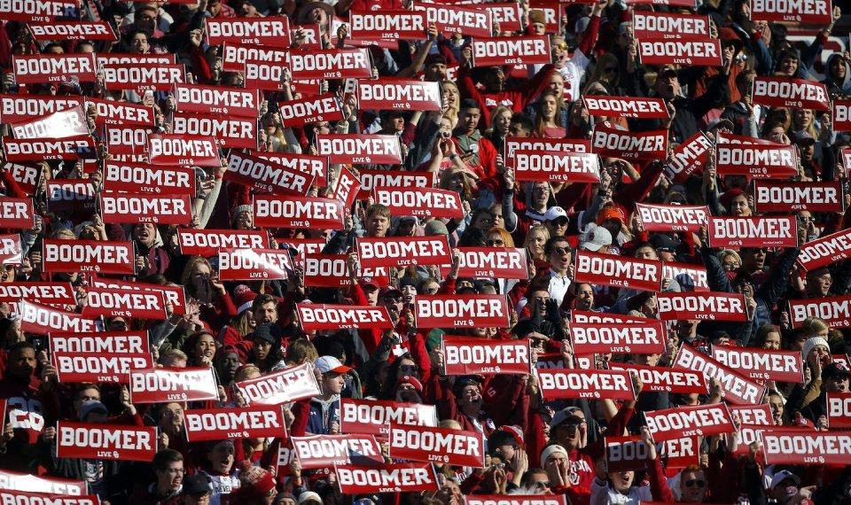 Photo - Oklahoma fans display signs during a Bedlam college football game between the University of Oklahoma Sooners (OU) and the Oklahoma State University Cowboys (OSU) at Gaylord Family-Oklahoma Memorial Stadium in Norman, Okla., Nov. 10, 2018.  Photo by Bryan Terry, The Oklahoman