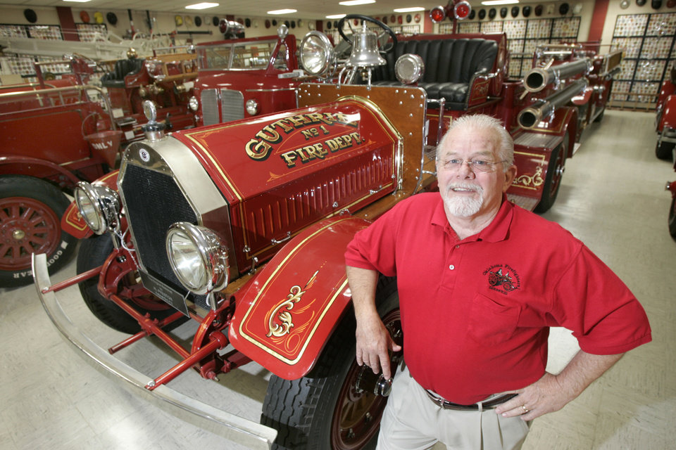 Photo - Mike Billingsley, manager of the Oklahoma State Firefighters Museum, poses with a 1919 Seagraves Pumper at the Oklahoma City museum. By Steve Gooch
