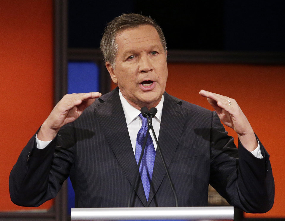 Photo - Republican presidential candidate, Ohio Gov. John Kasich speaks during the Fox Business Network Republican presidential debate at the North Charleston Coliseum, Thursday, Jan. 14, 2016, in North Charleston, S.C. (AP Photo/Chuck Burton)
