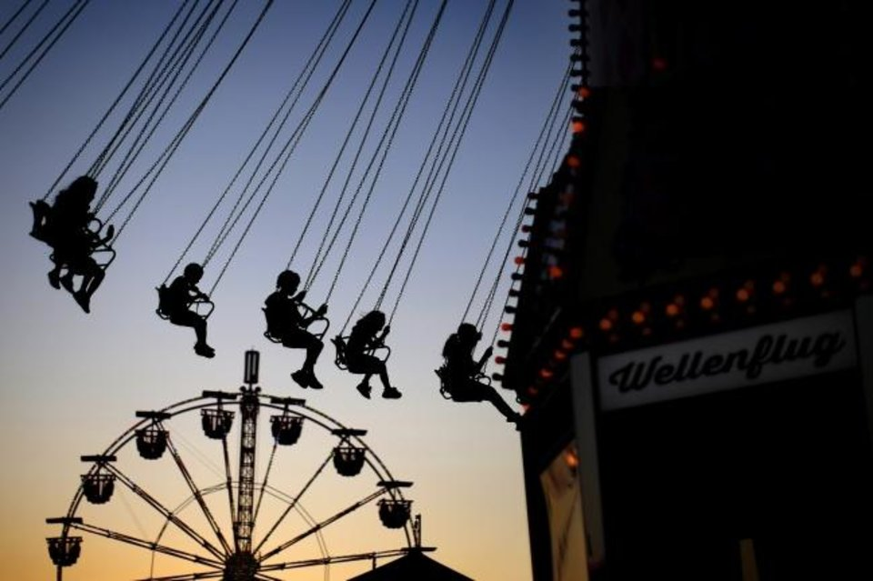 Photo -  Fairgoers enjoy a ride at the OKC Fairgrounds as the sun sets during the Oklahoma State Fair in Oklahoma City, Tuesday, Sept. 17, 2019. [Bryan Terry/The Oklahoman Archives]