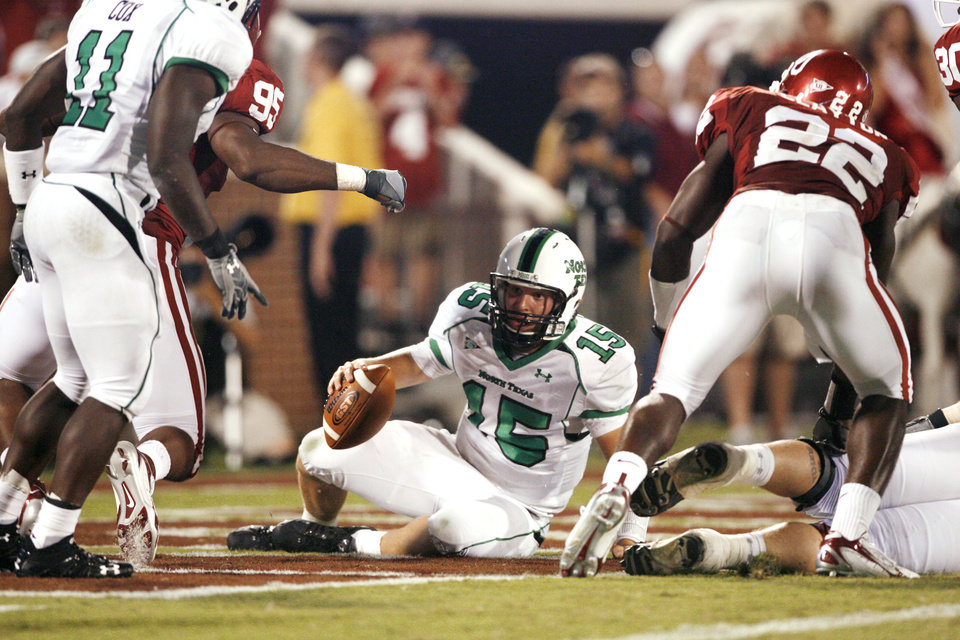 Photo - Quarterback Giovanni Vizza is tackled in the end zone for a safety by Alan Davis in the second half during the University of Oklahoma Sooners (OU) college football game against the University of North Texas Mean Green (UNT) at the Gaylord Family - Oklahoma Memorial Stadium, on Saturday, Sept. 1, 2007, in Norman, Okla.   By STEVE SISNEY, The Oklahoman